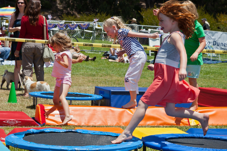 children playing on trampolines outdoor