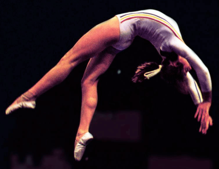 a gymnast doing perfect back handspring movement