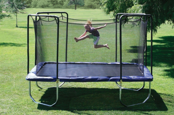 a girl jump high on good construction skywalker trampoline