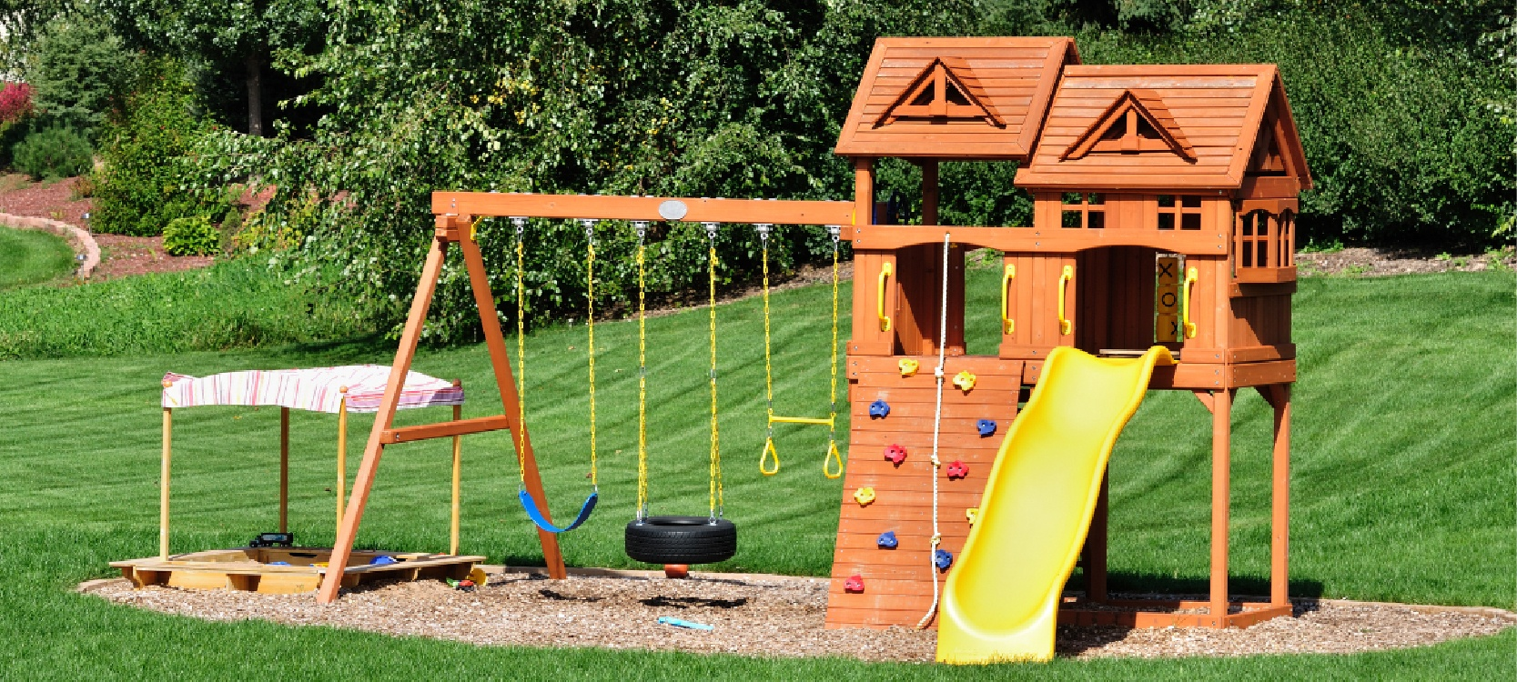the nice outdoor play area for kids in sunny backyard
