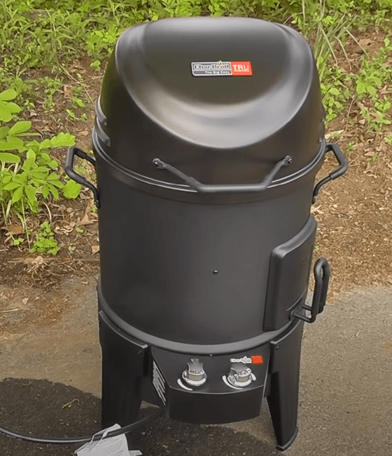 the vertical Char-Broil grill standing in the backyard
